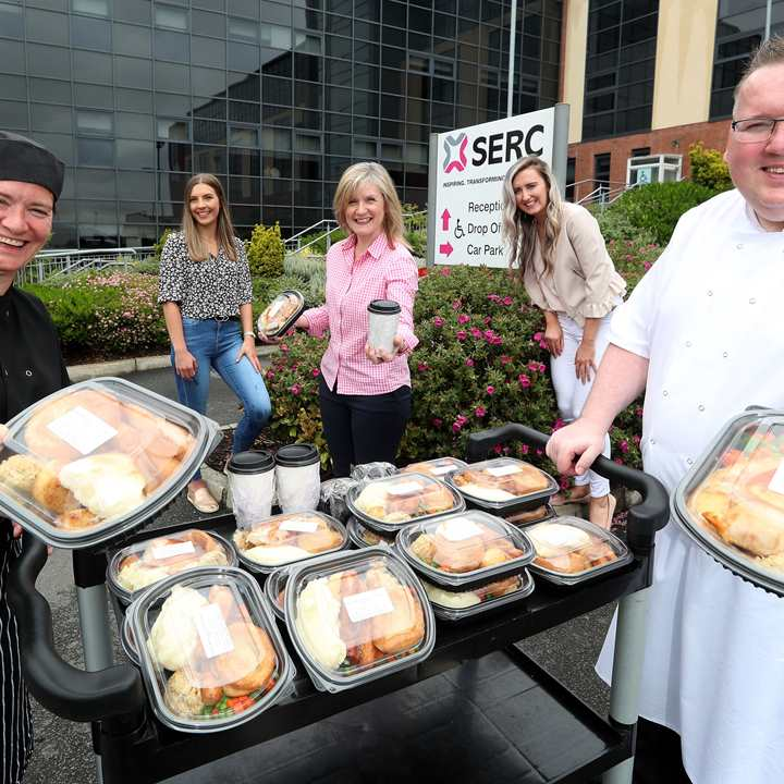 Serc catering team supplying hot cook meals to the community